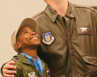 """HONORARY MEMBER: Alan Hinton, 11, of Youngstown, stands with his mentor Capt. Brian Hodor, who is a pilot of the C-130 aircraft in the Air Force Reserve. Alan was sworn-in Wednesday as an honorary Air Force Reserve second lieutenant in the """"Pilot for a Day"""" program at the Youngstown Air Reserve Station."""