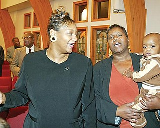 PRAISE: Elizabeth Missionary Baptist Church in Youngstown opened its doors for a Thanksgiving eve service. Singing were Yvette Walker, left, and Adrien Boudrey with her 15-month-old grandson Kevin Boudrey — all from Youngstown.