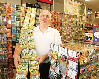 LOTTO SALES: John Colla of Collas Market in Austintown has long had one of the busiest lottery sales in Mahoning County. Colla said the downturn economy has spurred lottery sales even higher.