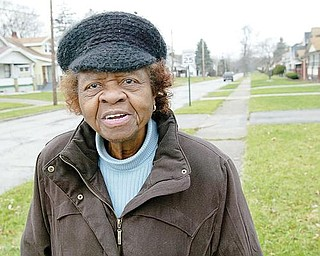 HOLDING ON: Ruby Yates, 85, has lived in the same Idora neighborhood on Youngstown's South Side for almost 40 years. While the neighborhood used to be a gem of the Mahoning Valley, the area has regressed, she said. In recent years, however, some positive change has occurred, she says.