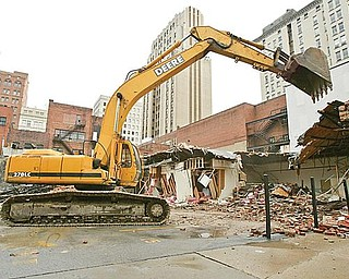 DEMOLITION: Pro Quality Land Development of Campbell is demolishing three vacant buildings near Youngstown City Hall. The land will be converted into a parking lot addition.