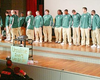 William D. Lewis/The Vindicator Ursuline coach Dan Reardon speaks at Ursuline HS pep rally Thursday.