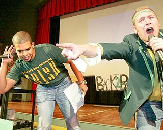 William D. Lewis/The Vindicator Steven Bernard, left, and Louis Isabella both Ursuline HS senoirs served as MC's during Ursuline HS pep rally Thursday afternoon in preparation for State Championship game. Rally was held in the school auditorium.