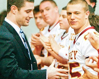 STATE CHAMP: Kyle McCarthy, a former Cardinal Mooney and current University of Notre Dame football player, wishes football players luck for their state championship game. McCarthy won a state championship with Mooney in 2004.