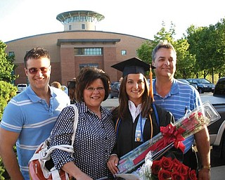 Melissa Bayus celebrates graduating with honors in May from Mercy College of Northwest Ohio with a degree in nursing. Pictured with her are, from left, her brother, Dan Bayus, Jr.; her mother, Lisa Bayus; and her father, Dan Bayus.