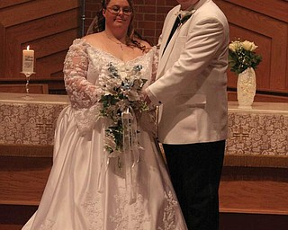 Mr. and Mrs. Brian Orzechowski of Youngstown were married Sept. 26.