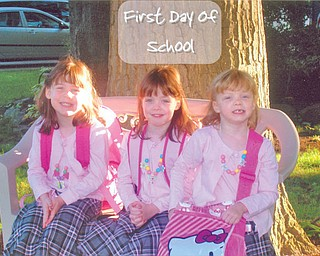 Their first day of school at Watson Elementary in Austintown was a big deal for Moira, Emma and Gretchen George.