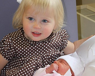 Big sister Payton Zwingler meets her baby sister Parker for the first time on June 3. They are the daughters of Chad and Alyson Zwingler of Columbiana.