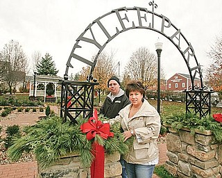 SPRUCING UP: Deborah and Harry Shields adds finishing touches on decorations at Tylee Park in Hubbard. The couple spearheaded a campaign to clean up the park.