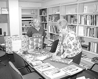 "WRAPPERS: Wrapping presents at the Family Practice Center at Northside Medical Center are employees Kathi Wyllie, left, and Dorothy Andrews, R.N. This year, the center has early presents for pediatric patients. The ones who have an office visit to be immunized any time in December will receive a new toy that was generously donated by either an NMC employee, physician, day care provider or church. Nearly 200 toys were donated. ""The Family Practice Center came up with the idea based on low immunization rates in Ohio,"" said Lisa Weiss, M.D., director of the center.