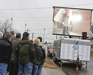 The Vindicator/Lisa-Ann Ishihara-- Kaluza family watches a video reel before entering their new house. Sunday December 13, 2009