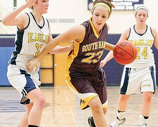 South Range's Gabrielle Naples (23) against United Ruth Prosko (30)