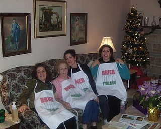 A DIFFERENT KIND OF FAMILY TREE: Christina Smith of Canfield presented her aunt, Geri DeCenso; her grandmother, Margaret Orlando (who is turning 90 in May); her mom, Mary Jo Olson; and her aunt, Jackie Orlando of Columbus, with aprons celebrating their cooking and the roots of their Italian heritage.