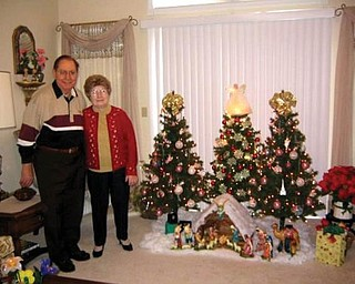 Joseph and Valeria Demidovich of Boardman, who have been married for 60 years, celebrate the holidays with three trees!
