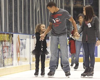 The Vindicator/Lisa-Ann Ishihara --- L-R Destini Gray (5) with her older brother Deven (14) Gray along with Veronica Dorbish (14) - all of Austintown - ice skate at the Covelli Centre for First Night Youngstown 2010