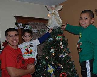 Renee Bero says this picture was taken the evening her grandsons, Jay, Alex and Santino Jorge of Struthers, placed the angel on top of their family Christmas tree.
