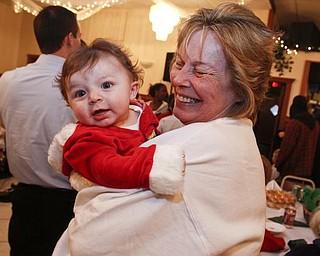 The Vindicator/Lisa-Ann Ishihara -- Aiden Strawderman (5 months) of Warren waits in his grandma's arms Betty Strawderman of Warren to see Santa at Aulizio's Banquet Center in Warren