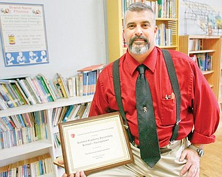 The Vindicator/Robert K. Yosay -----Ray Pallante  - proudly shows off his improvement in the state acheivement tests.. certificate at Summit Academy--  on Oak Hill in Youngstown 1222009