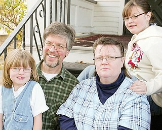The Collier family is considering pulling their daughters from Warren City schools and sending them to a private school as part of Ed Choice plan. They are Richard and Barbra Collier and daughters Abigal, 7, and Kimberly, 13.