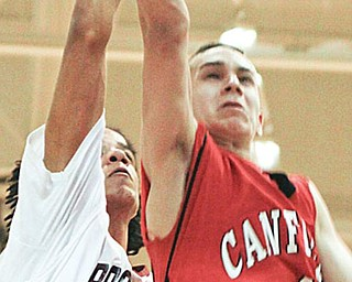 Canfield Dan Campolito (4) blocked by Boardman Dayne Hammond (24) during the second period at Boardman High School.