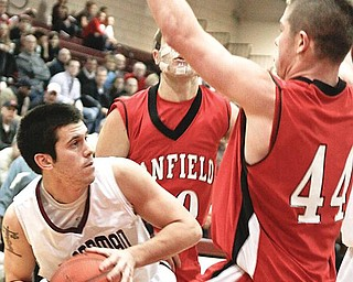 NOWHERE TO GO: Boardman guard Ben Mathey, left, gets blocked in by Canfield defenders Ryan Abraham (10) and Donnie Allison during the first quarter of Tuesday's game at Boardman High.