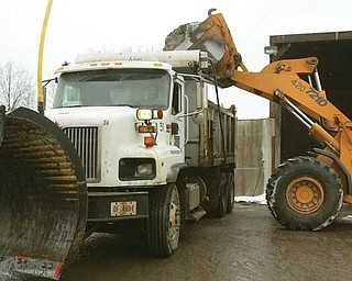 SALT CENTRAL: Road salt is placed into a Mahoning County plow truck at the county engineer's department complex on Industrial Road.