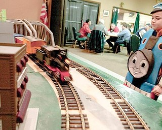 Wearing a Thomas the Tank Engine outfit, Bryce Pavlov, 4, of Poland, watches a model train rush past during the train show at McMenamy's on Sunday afternoon.