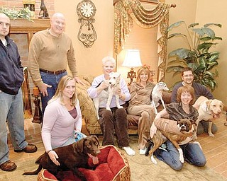COMMON CAUSE: Some residents are trying to gather funds to build a dog park in Boardman Township Park. Standing are Jason Fellows and Richard Fabian. Sitting and kneeling, from left, are Jennifer Fellows with her chocolate Labrador Roscoe, Linda Fabian with her wirehaired terrier Abbey, Vicky Loree with her Italian greyhound Luigi, Abbey Loree with her boxer Izzy and Jason Loree with his Labrador Bowie.