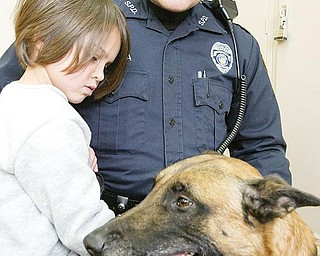 PROTECTOR AND FRIEND: The Campbell Police Department  is trying to raise money to buy and train a police dog. Struthers Police Officer Jason Murdza is shown with his police dog, Rebel, and his 4-year-old daughter, Tori. Campbell police have used Rebel to help solve crimes in the city.