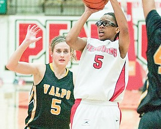 YSU's Kenya Middlebrooks (5) takes a shot in front of Valparaiso's Betsy Adams (5) during the second half of a game at YSU's Beeghley Center on Thursday evening.