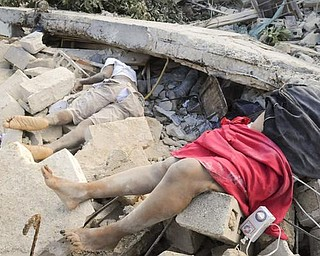 Bodies lie in the rubble along Delmas road the day after an earthquake struck Port-au-Prince, Haiti, Wednesday, Jan. 13, 2010.  A 7.0-magnitude earthquake, the largest ever recorded in the area, rocked Haiti on Tuesday.