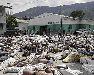 Hundreds of bodies of earthquake victims lay outside the morgue in Port-au-Prince, Thursday, Jan. 14, 2010.  A 7.0-magnitude earthquake struck Haiti Tuesday.