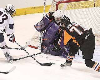 NET PLAY: Youngstown Phantoms goalie Mike Mahalak and defenseman Dan Senkbeil try to keep Team USA's Travis Boyd (93) from scoring during Monday's game at the Covelli Centre.