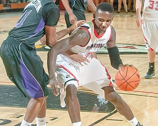 PRIME TIME: YSU's Sirlester Martin (5) dribbles past a defender during a game at the Beeghly Center. Martin and the Penguins will host the Milwaukee Panthers Friday at 7 p.m. The game will air on ESPNU.