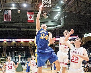 McDonald's Matthias Tayala attempts a layup against Columbiana's Austin Barbato (23) Nick Good (30) and Tyler Demeade (22) during the first quarter  of a game at the Covelli Centre on Tuesday evening.