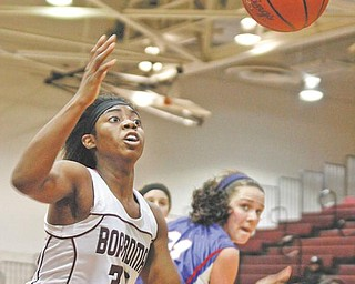 GAME ACTION: Boardman's Doriyon Glass (33), above,  goes for the rebound before it goes out of bounds against Uniontown Lake during Wednesday's game. The Spartans defeated Federal League rival Uniontown Lake 65-37.