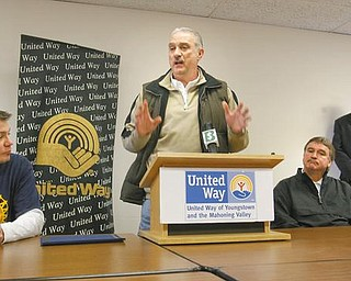 GOAL REACHED: Jim Graham, at the podium, president of United Auto Workers Local 1112 at the General Motors Lordstown Complex, explains how union workers helped the United Way of Youngstown and the Mahoning Valley exceed its 2009 financial goal of $2.5 million. Also appearing at Wednesday's press conference were, from left, David Green, president of UAW Local 1714 at Lordstown; John Donahoe, manager of the complex and 2009 campaign chairman; and Robert Hannon, UW president and chief professional officer.