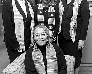 LADIES IN WAITING: Satisfied that arrangements have been completed for the Black and White Snowflake Ball, to be sponsored by the Epsilon Mu Omega Chapter of Alpha Kappa Alpha Sorority, are, seated, Sarah Brown-Clark, member of the program committee; and standing from left, Beverly Fortune, chair of the event; Robin Bradley, ticket chair; and Carole Staten, technology chair.