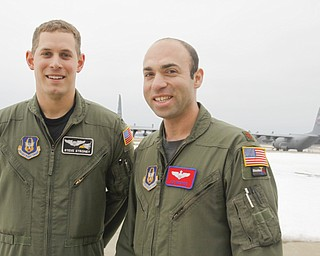 First Lieutenant and Co-Pilot Steve Stroney of Liberty with Pilot and Major Joe George of Pittsburgh with the C130 - H2 Aircraft behind them.