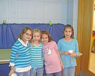 Friends take a break from bingo to enjoy refreshments provided by the Watson PTA. From left, Isabella Bindas, 7, Haley Molynarski, 7, Morgan Reed, 7, and Shannon Carr, 7.