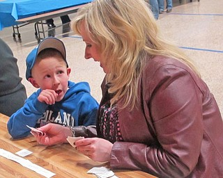 Sentences are fun with this word sorting activity. Mason Planey (left) consults his mother, Kelly Planey, to make sure his sentence is correct.