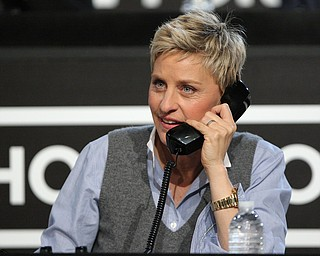 """In this image released by Hope for Haiti Now,  Ellen DeGeneres works the phone bank at the """"Hope for Haiti Now: A Global Benefit for Earthquake Relief"""", on Friday, Jan. 22, 2010 in Los Angeles. (AP Photo/Mark Davis/Hope for Haiti Now)"""