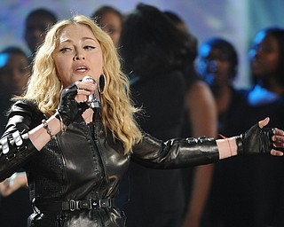 """In this image released by Hope for Haiti Now, Madonna performs at """"Hope for Haiti Now: A Global Benefit for Earthquake Relief"""", on Friday, Jan. 22, 2010, in New York. (AP Photo/Evan Agostini/Hope for Haiti Now)"""