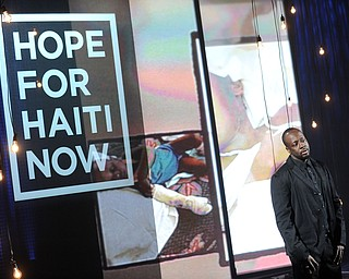 """In this image released by Hope for Haiti Now,  Wyclef Jean speaks at """"Hope for Haiti Now: A Global Benefit for Earthquake Relief"""", on Friday, Jan. 22, 2010, in New York. (AP Photo/Evan Agostini/Hope for Haiti Now)"""