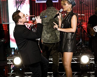 """In this image released by Hope for Haiti Now, Bono, left, and Rihanna perform at the """"Hope for Haiti Now: A Global Benefit for Earthquake Relief"""", Friday, Jan. 22, 2010 in London. (AP Photo/MJ Kim/Hope For Haiti Now)"""