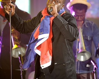 """In this image released by Hope For Haiti Now, Wyclef Jean performs at """"Hope for Haiti Now: A Global Benefit for Earthquake Relief"""", on Friday, Jan. 22, 2010 in New York. (AP Photo/Evan Agostini/Hope for Haiti Now)"""