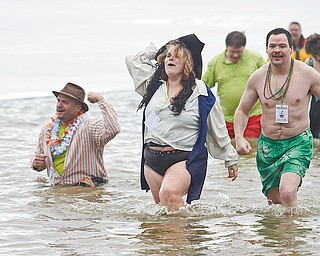 FREEZIN' FOR A REASON: Linda Welling and her husband, Dave, of Newton Falls, participate in the Polar Bear Plunge at Mosquito Lake in Bazetta Township. Saturday's event raised more than $25,000 for the Special Olympics.