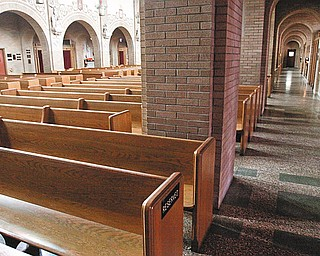 VICTIM'S PEW: This front corner pew at St. Dominic Church on Lucius Avenue is where Angeline Fimognari sat during Masses.