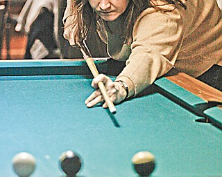 Michelle Beard of Boardman competes in the American Poolplayers Association Second Chance Tournament at Avon Oaks Ballroom in Girard on the team Dark Knights.