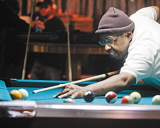 HIS SHOT: Richie Ross of Youngstown competes in the American Poolplayers Association Second Chance Tournament at Avon Oaks Ballroom in Girard.